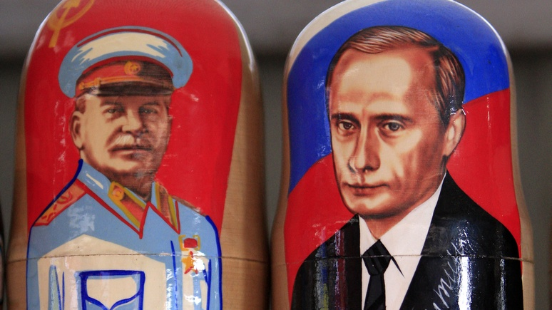 Traditional Matryoshka dolls or Russian nesting dolls bearing the faces of Russia's president elect and current PM Putin and former Soviet dictator Stalin are seen in a souvenir shop in Kiev
