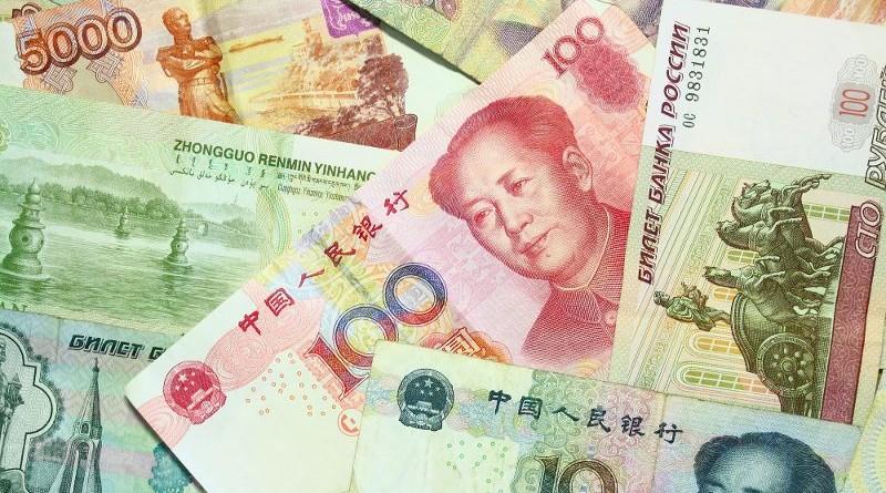 """На Уолл-стрит паника: Китай запускает новый платежный механизм """"юань-рубль"""""""